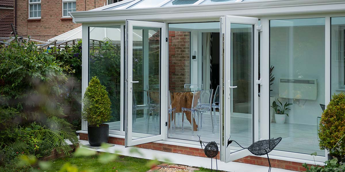 Large Glass To Floor Conservatory With French Doors